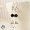 boucles d'oreilles pour femme avec une perle noire et des menottes 50 nuances