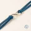 Bijou fait main composé d'une breloque infini et de suédine bleue