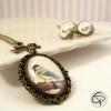 sautoir avec dessin de mésange dans médaillon bijou romantique femme