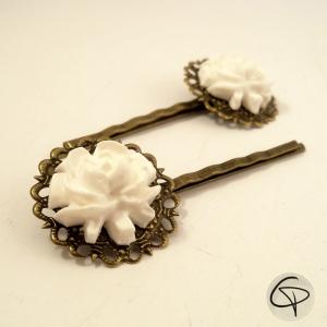 Pinces à fleur blanche