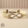 Délicat bracelet blanc pour femme avec breloque infini