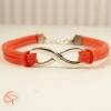 Bijou décoré du symbole infini suédine rouge corail