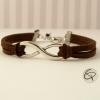 Joli bracelet symbolique avec une paire de cordons marron