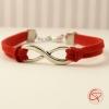 Bracelet avec symbole mouvement perpétuel et cordons rouges