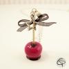 Sautoir pomme d'amour fuchsia avec nœud ruban noir