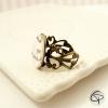 Bague bronze maman qui déchire anneau dentelle