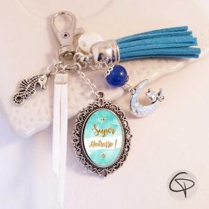 Porte-clef pompon bleu turquoise - cadeau original maîtresse