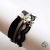 bracelet féminin dentelle noire breloque tête de mort os en croix