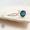 bracelet femme médaillon bleu vert émeraude tête de chat géométrique