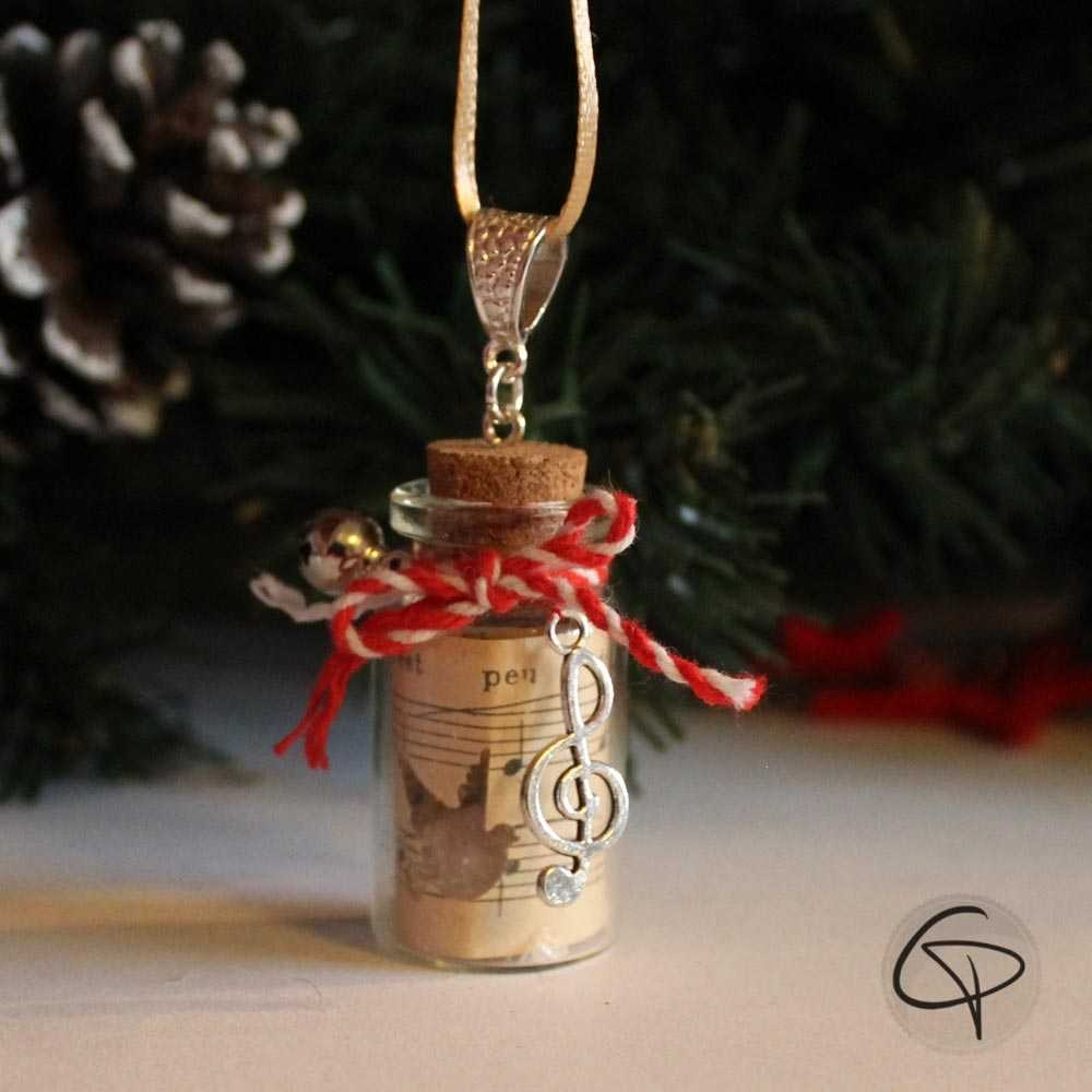 Décoration sapin de Noël fiole en verre clef de sol grelot musical