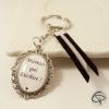 Porte-clef maman qui déchire métal argenté colori rubans au choix cadeau fête des mère