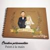 livre d'or pour mariage avec une illustration des futurs époux