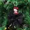 poupée en bois peint main avec tenue de fête noire à mettre dans le sapin