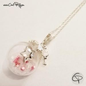 Sautoir de Noël fiole ronde en verre avec sucre d'orge et étoile argentée