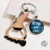 porte-clé décapsuleur en forme de pied et médaillon personnalisé