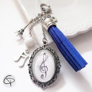 Bijou de sac clé de sol pompon bleu accessoire fan de musique