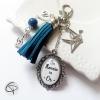 Cadeau marraine porte-clef pompon bleu breloques clé de sol oiiseau et chat