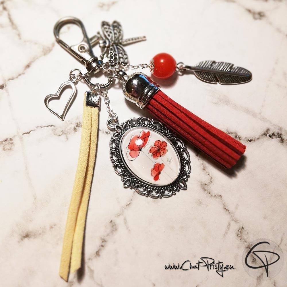 Porte-clef de sac original avec une illustration de coquelicots de créateur
