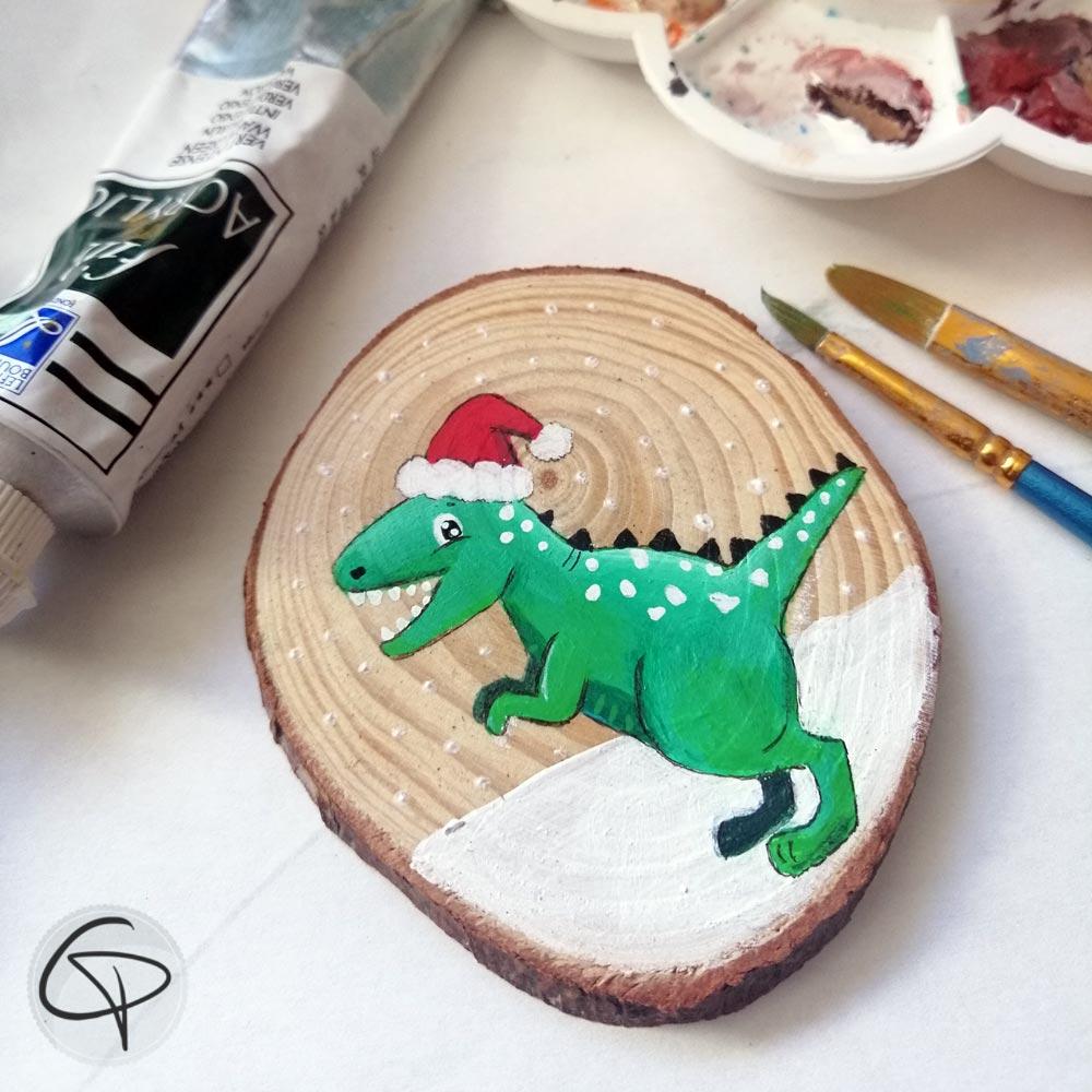 Petit dinosaure tout vert pour décorer le sapin de Noël de votre enfant